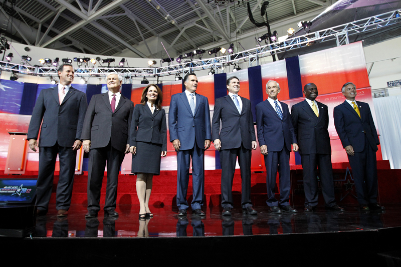Santorum, Gingrich, Bachmann, Romney, Perry, Paul, Cain, and Huntsman stand before the start of the GOP presidential primary debate in Simi Valley