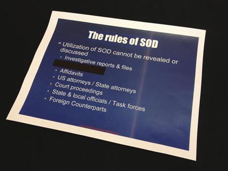 A slide from a presentation is seen about a secretive information-sharing program run by the U.S. Drug Enforcement Administration's Special Operations Division